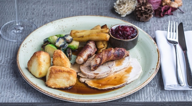 Norfolk bronze turkey breast, stuffed leg, chipolata, Brussels sprouts, roasted potatoes, cranberry sauce